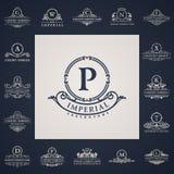 Luksusowi roczników logowie ustawiający Kaligraficzny list Obrazy Royalty Free
