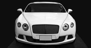 Luksusowy samochodowy Bentley Kontynentalny GT przy miasto ulicą Zdjęcia Stock