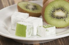 Lukum (Turkish Delight) with kiwi fruit Stock Images