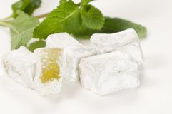Lukum (Turkish Delight) with mint Royalty Free Stock Images