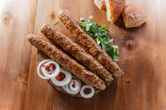 Lula kebab with herbs Royalty Free Stock Photography