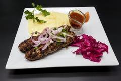 Lula Kebab.Kebab.Traditional Oriental Dish, Barbecue Shish Kebab. Lamb, Onions, Cabbage, Mashed Potatoes Spicy Tomato Sauce On Pla Stock Image