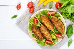 Lula-kebab is a meat dish. Traditional for the Caucasus, in Central Asia and Turkey. Minced meat strung on a skewer and fried. Serve on a plate with lettuce stock photos