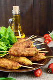Lula-kebab is a meat dish. Traditional for the Caucasus, in Central Asia and Turkey. Minced meat strung on a skewer and fried. Serve on a plate with lettuce stock photography