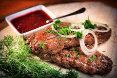 Lula kebab with onions and greens Royalty Free Stock Photography