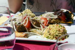 Lula kebab with rice and vegetables Stock Photos