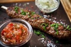 Lula kebab with tomato salsa Royalty Free Stock Photo