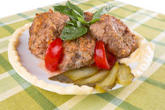 Lula lamb and tomato on a plate on the table Royalty Free Stock Photos