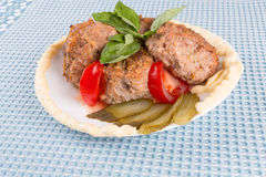 Lula lamb and tomato on a plate on the table Stock Photography