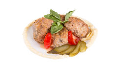 Lula lamb and tomato on a plate Stock Images