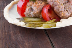 Lula lamb and tomatoes on a plate Royalty Free Stock Image