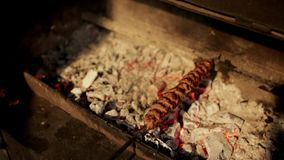 Lulah Kebab is fried on embers on the grill stock video