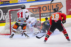Lulea, Sweden - March 18, 2015. Karl Fabricius  (#52 Lulea Hockey) slides with full speed into opponents goalie. Swedish Hockey Le Royalty Free Stock Photography
