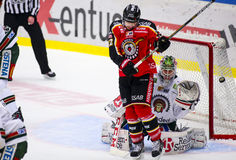 Lulea, Sweden - March 18, 2015. Lars Johansson  (#1 Frolunda Indians) can't see the puck. Swedish Hockey League-game, between Lule Stock Photography