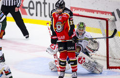 Lulea, Sweden - March 18, 2015. Lars Johansson  (#1 Frolunda Indians) can't see the puck. Swedish Hockey League-game, between Lule Stock Photo