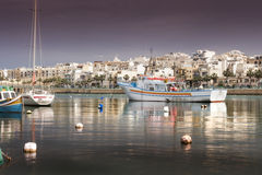 Lull. Peaceful harbor in Malta in a windless day stock photo