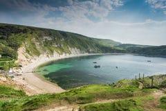 Lullworth liten vik i den Dorset kusten, UK Arkivfoto