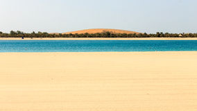 Lulu Island. Beach at Corniche of Abu Dhabi with Lulu Island in the background Royalty Free Stock Photos
