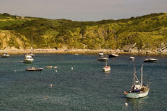 Lulworth Bay. Boats docked in Lulworth Bay UK photographed on a hot summers day Stock Photo
