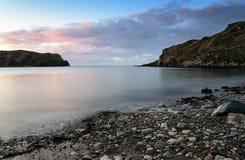Lulworth Cove. Sunrise at Lulworth Cove on Dorset's Jurassic Coast Stock Image