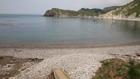 Lulworth Cove beach Dorset England UK PAN Royalty Free Stock Photography