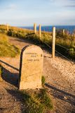 Lulworth Cove Campsite Mile Stone and Coast Path at Sunset royalty free stock photos