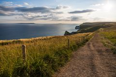 Lulworth Cove Coast Path and Rolling Cliffs at Sunset stock photography