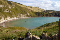 Lulworth Cove Dorset. From the South-West coastal path. This coastline is noted for its fossils and part of the famous Dorset and East Devon Jurassic Coast and Stock Photos