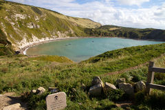 Lulworth Cove Dorset England. Lulworth Cove Dorset from the South-West coastal path. This coastline is noted for its fossils and part of the famous Dorset and Royalty Free Stock Photos