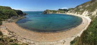 Lulworth Cove - Dorset - England. Lulworth Cove near West Lulworth, a village in the Purbeck district of Dorset on the south coast of England. The village is a Stock Images