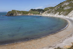 Lulworth Cove - Dorset - England. Lulworth Cove near West Lulworth, a village in the Purbeck district of Dorset on the south coast of England. The village is a Stock Photos