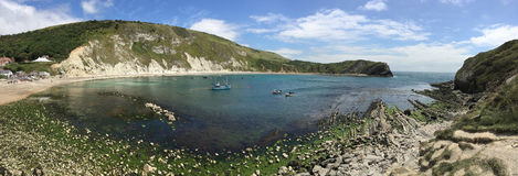 Lulworth Cove - Dorset - England. Panoramic view of Lulworth Cove near West Lulworth, a village in the Purbeck district of Dorset on the south coast of England Stock Image