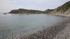 Lulworth Cove Dorset England UK top tourist attraction at sea level Royalty Free Stock Image
