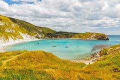 Lulworth Cove Dorset. Overlooking the beautiful Lulworth Cove Dorset England UK Europe royalty free stock photography