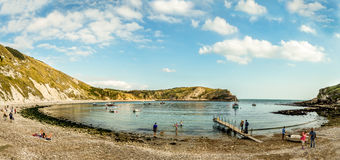 Lulworth Cove, Dorset, UK. A panoramic view of Lulworth Cove, an area of outstanding natural beauty, located on the South Coast of England. This rocky bay and Stock Image