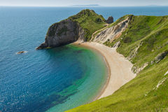 Lulworth Cove Durdle Door Cornwall England. Beautiful view at Durdle Door in Devon Cornwall, England. This is a great trail from Lulworth Cove Stock Image