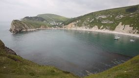 Lulworth Cove natural harbour Dorset England UK Stock Photos