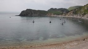 Lulworth Cove PAN harbour Dorset England UK Royalty Free Stock Image