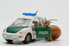 Lumaca e policecar Immagine Stock Libera da Diritti