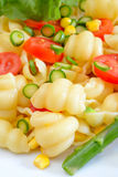 Lumaconi pasta by tomatoes sliced Stock Photography