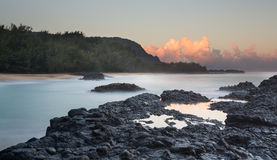 Lumahai Beach Kauai at dawn with rocks Royalty Free Stock Images