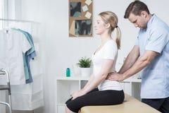 Lumbar spine mobilization Stock Photography