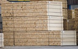 Lumber. Stacked in piles ready to ship stock images