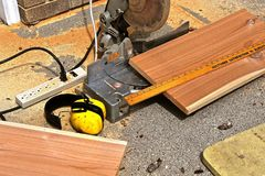 Lumber being cut on a mitre box saw Stock Photography