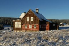 Lumber cottage in winter Stock Photos