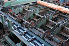 Lumber industry. Cutting line in saw mill Stock Image