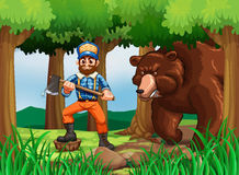 Lumber jack with axe and big bear in the woods Royalty Free Stock Photo
