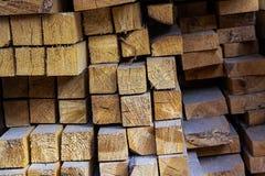 Lumber many square long blocks stack pile light beige design base web building pattern end boards stock photography