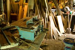 Lumber mill. A electric saw in an old barn used for cutting firewood Stock Photography