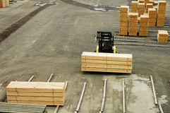 Lumber mill 6. Lumber being moved at a forest products processing plant Royalty Free Stock Image